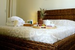 Luxury villas in Greece - Xenon Estate Althea master bedroom double rattan bed