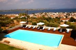 Xenon Estate luxurious villas panoramic view to the swimming pool as well as to the village of Spetses and the sea and mainland of Peloponnese